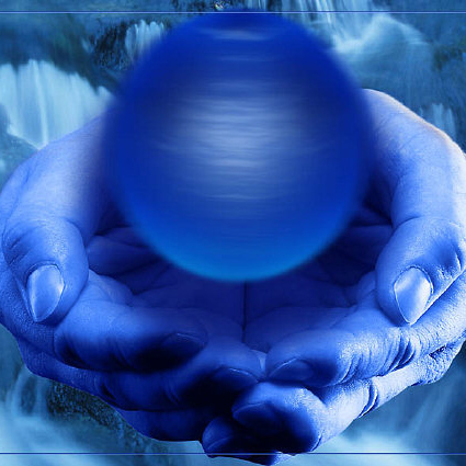 man-hands-holding-blue-sphere-in-front-of-waterfall